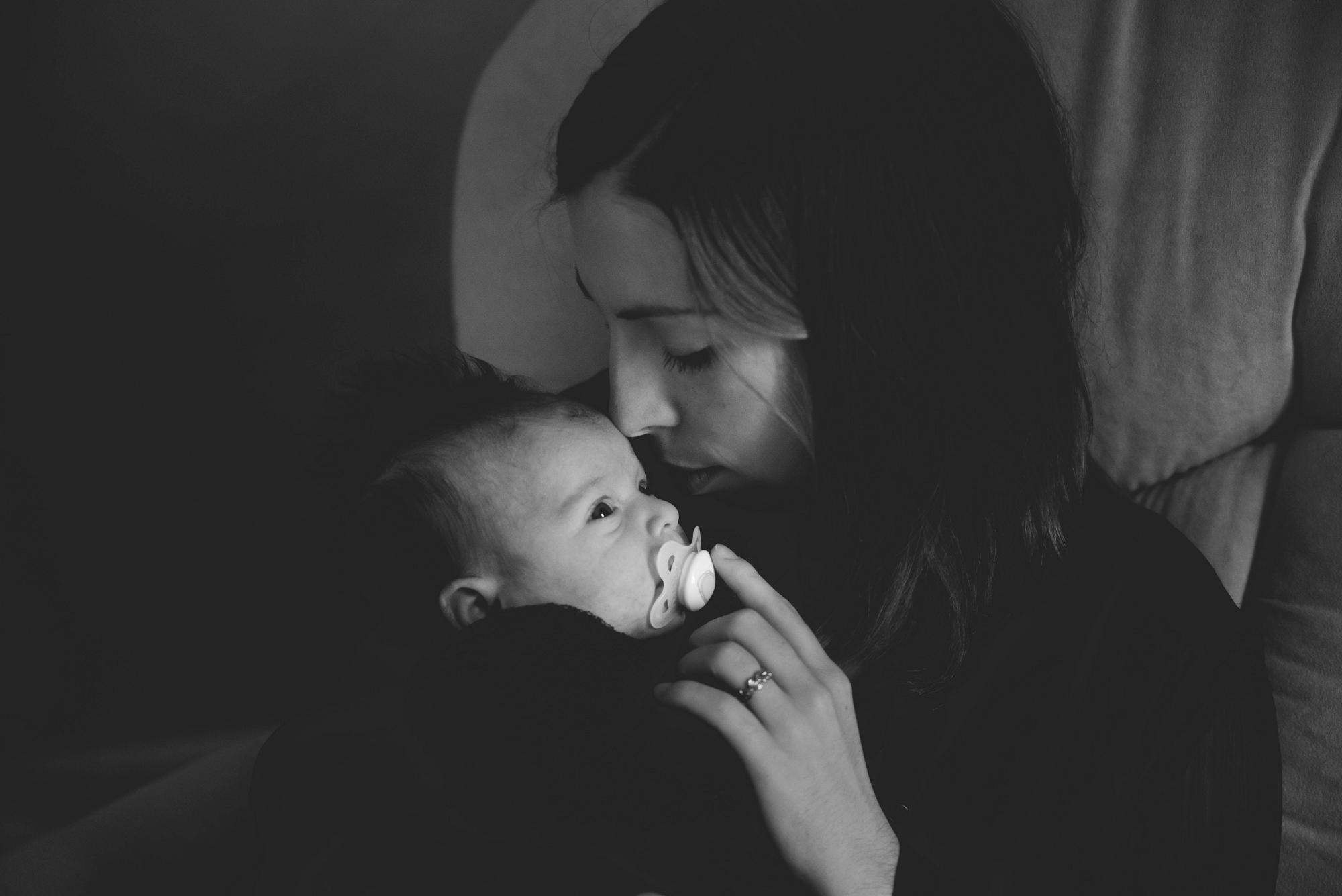 Mom snuggling newborn lifestyle session