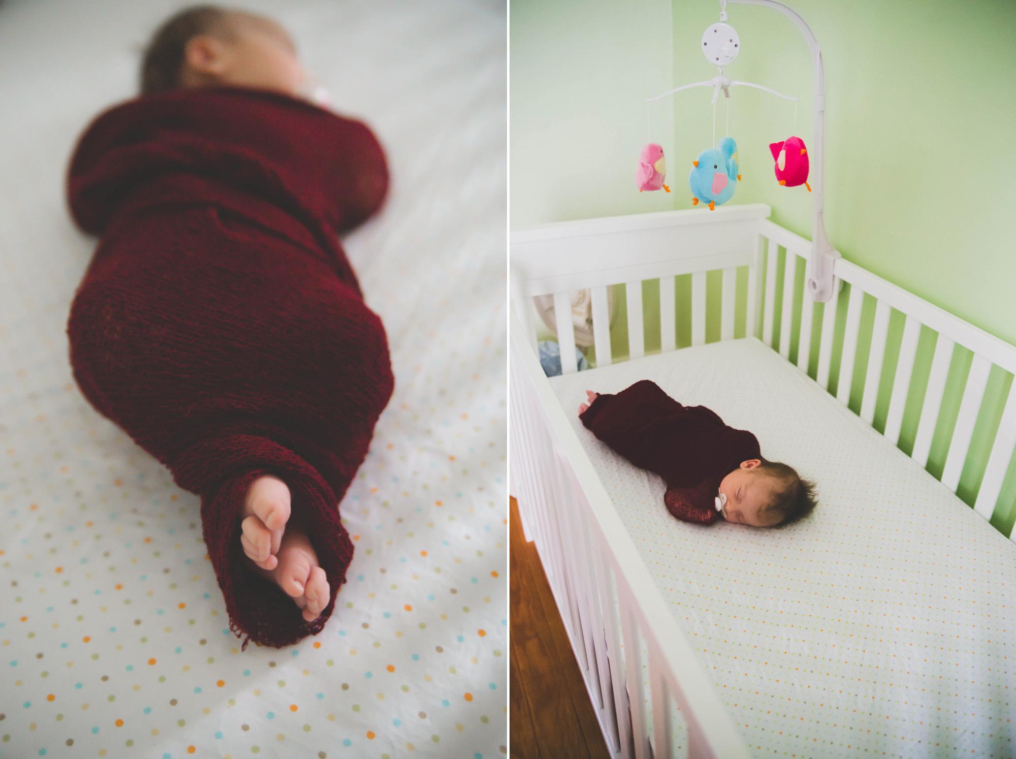 NEwborn girl in crib feet closeup lifestyle session