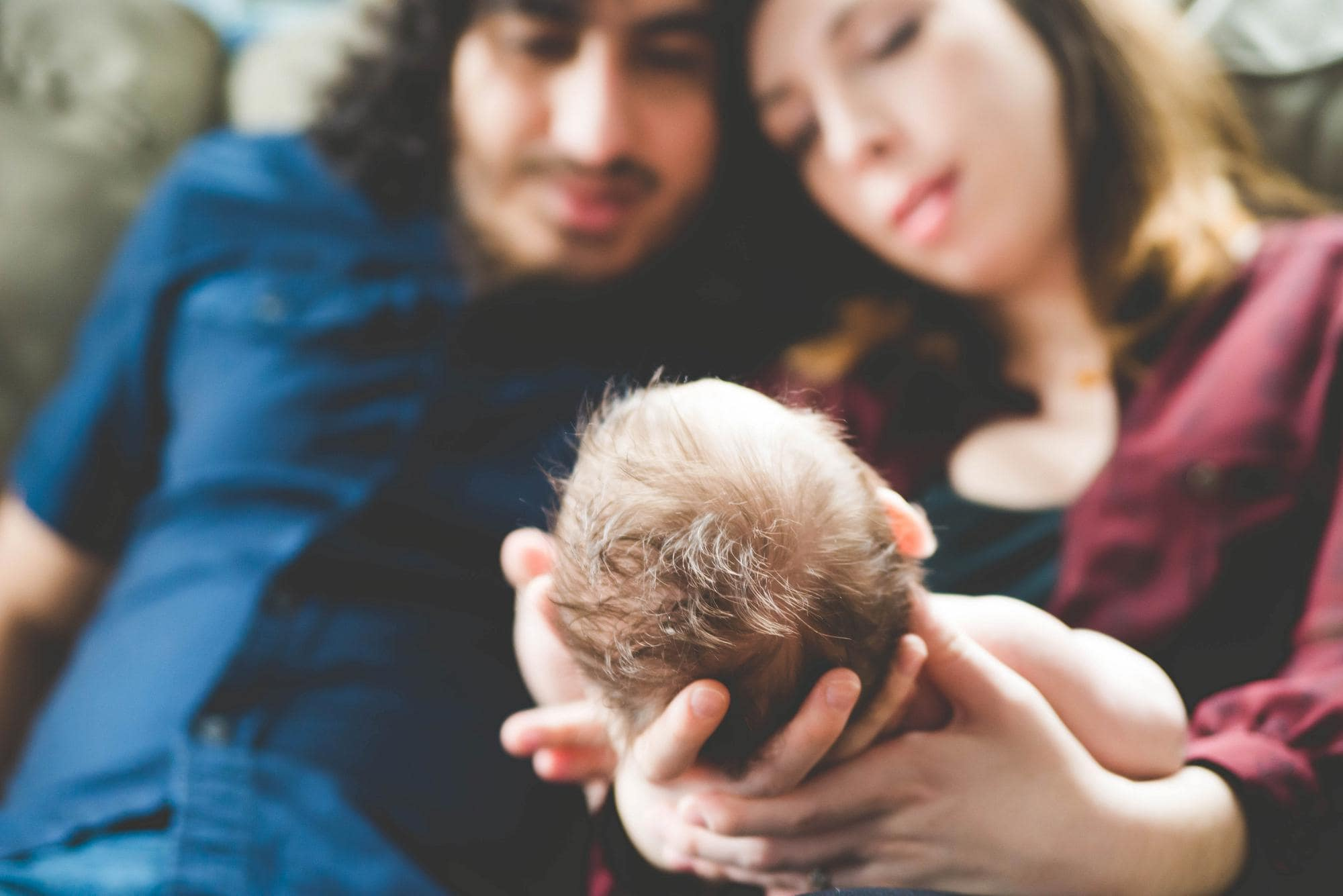 Parents looking down at newborn lifestyle session