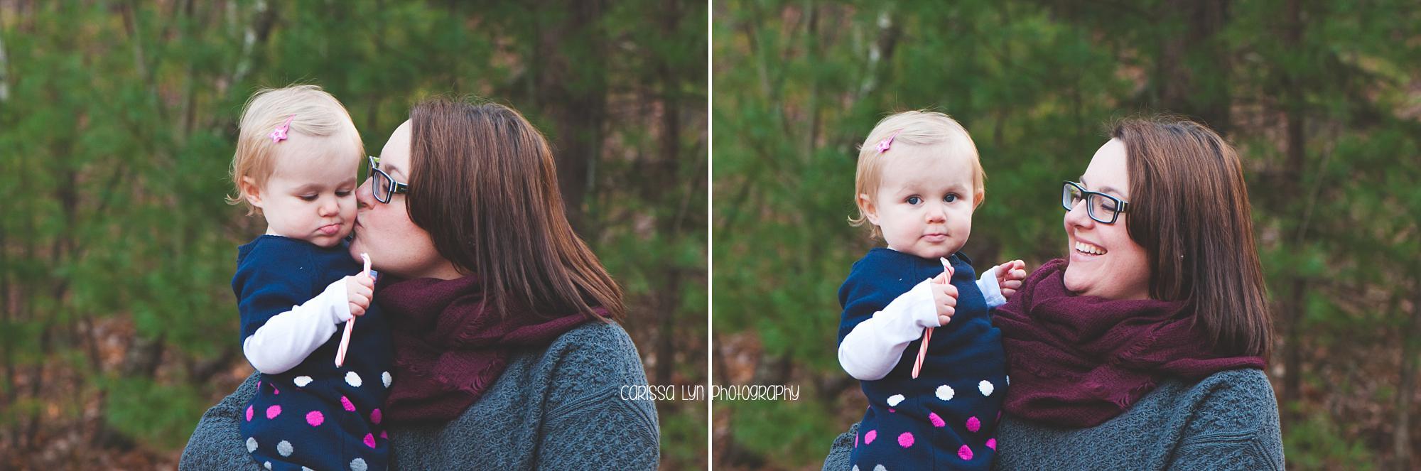 mom-kissing-toddler-girl-outside