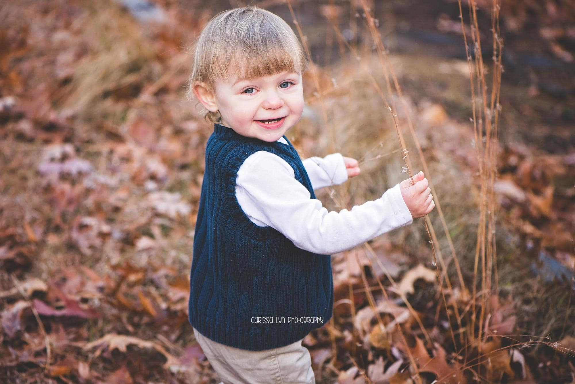 toddler-boy-standing-in-grass