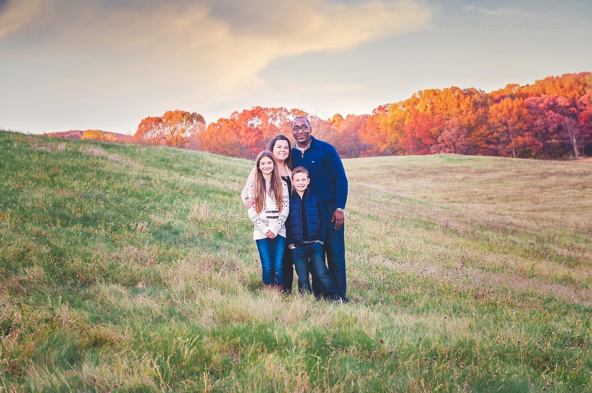 family-fall-field-at-sunset