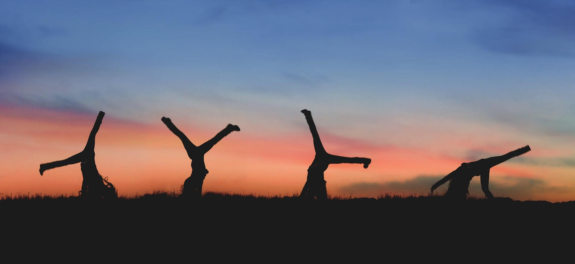 girl-cartwheel-sunset-silhouette
