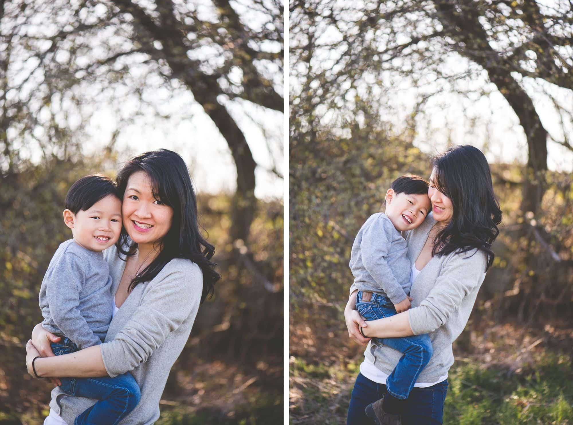 Mom hugging toddler son outside