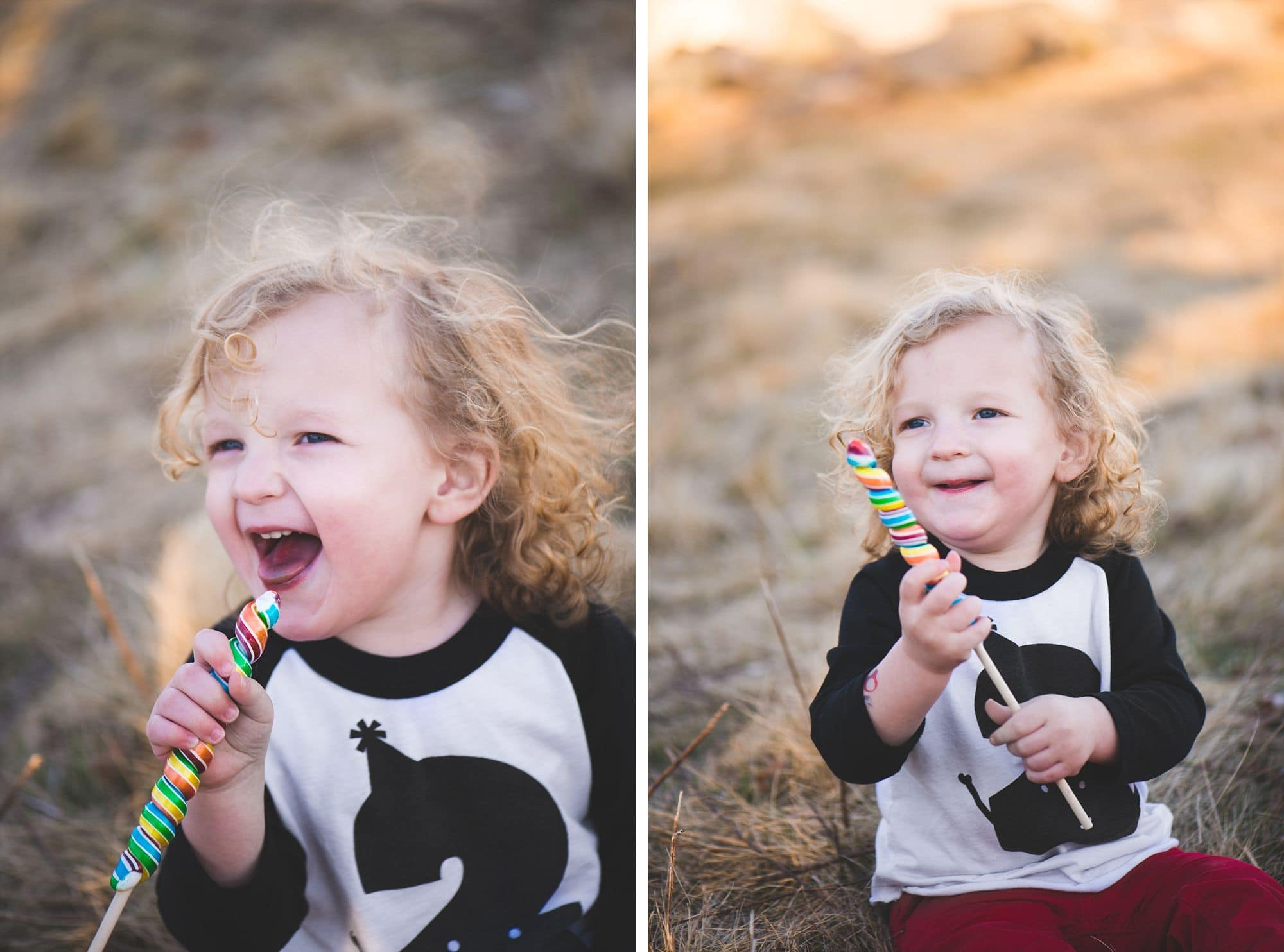 Two year old boy laughing and enjoying a candy in an open field