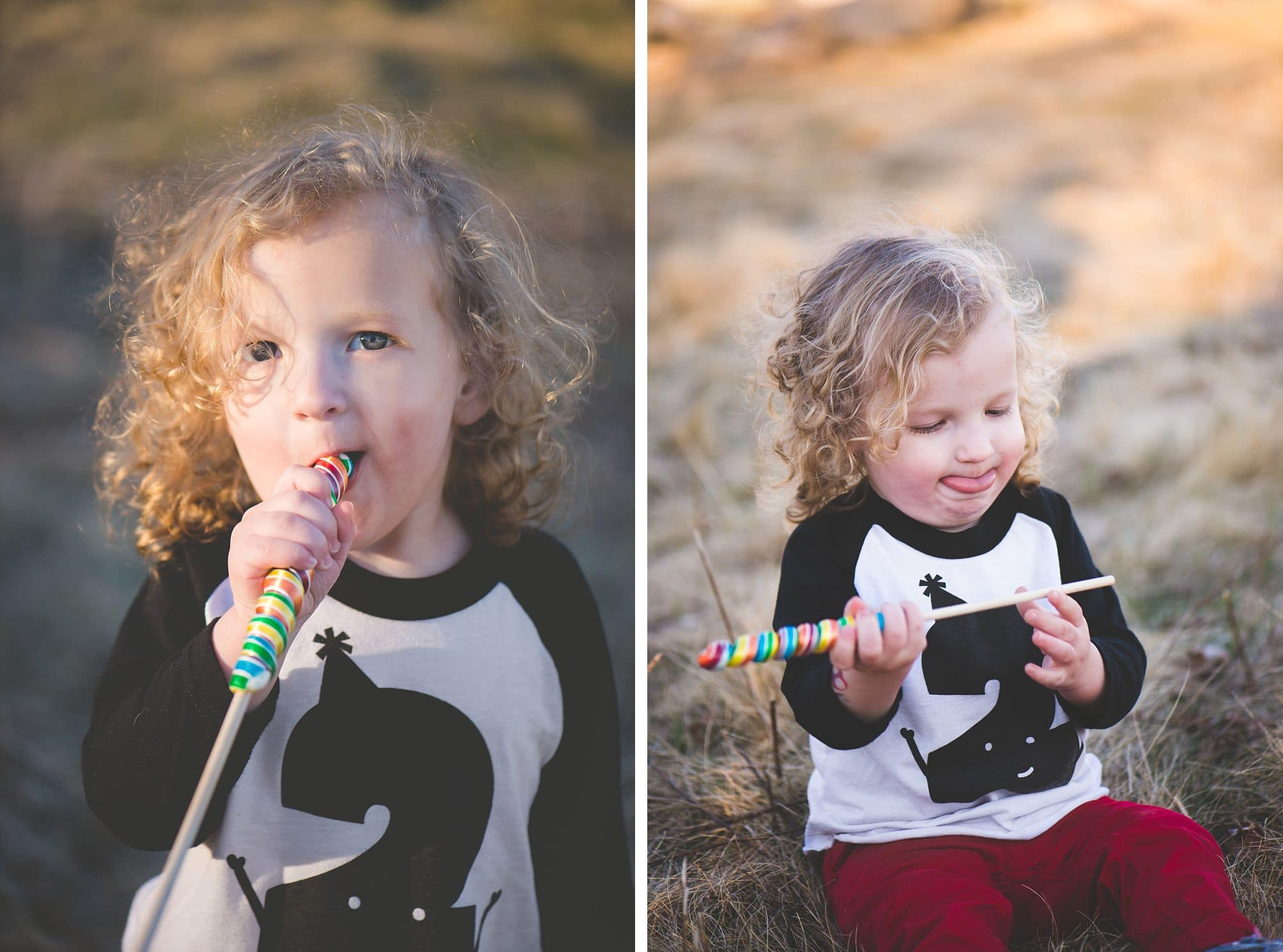 Two year old boy eats candy in a grassy meadow