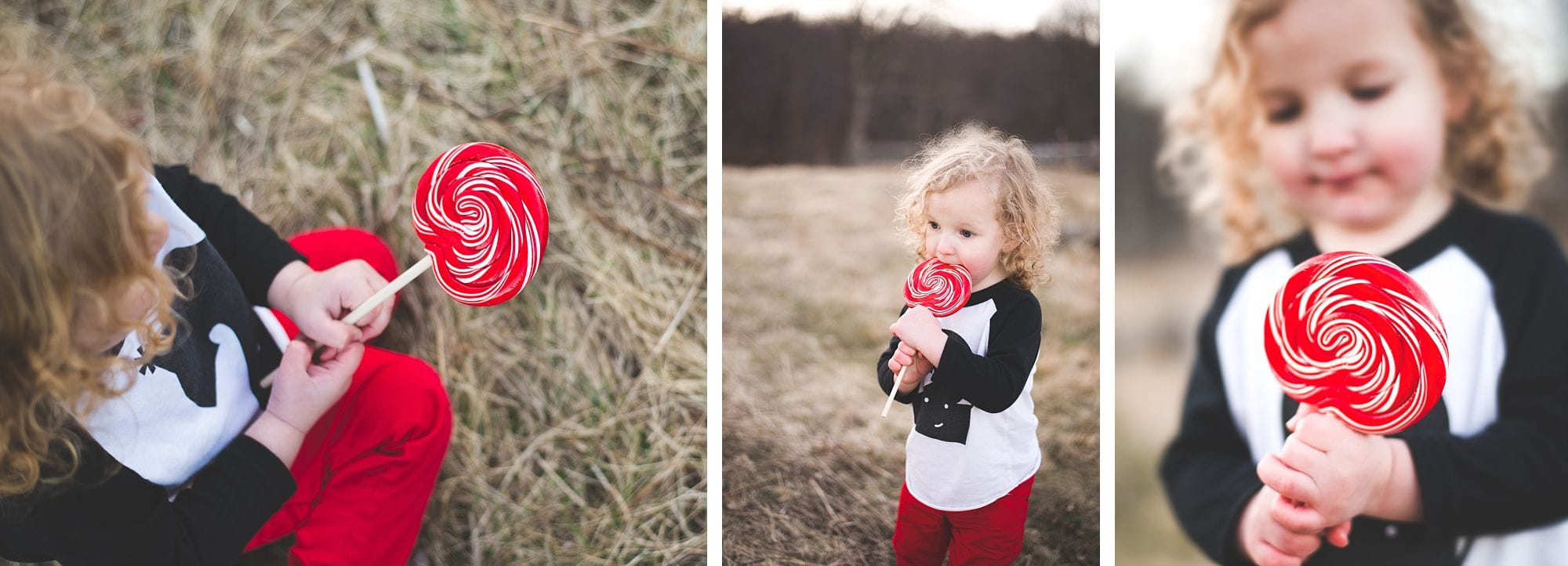 Toddler enjoys a giant red lollipop for his second birthday