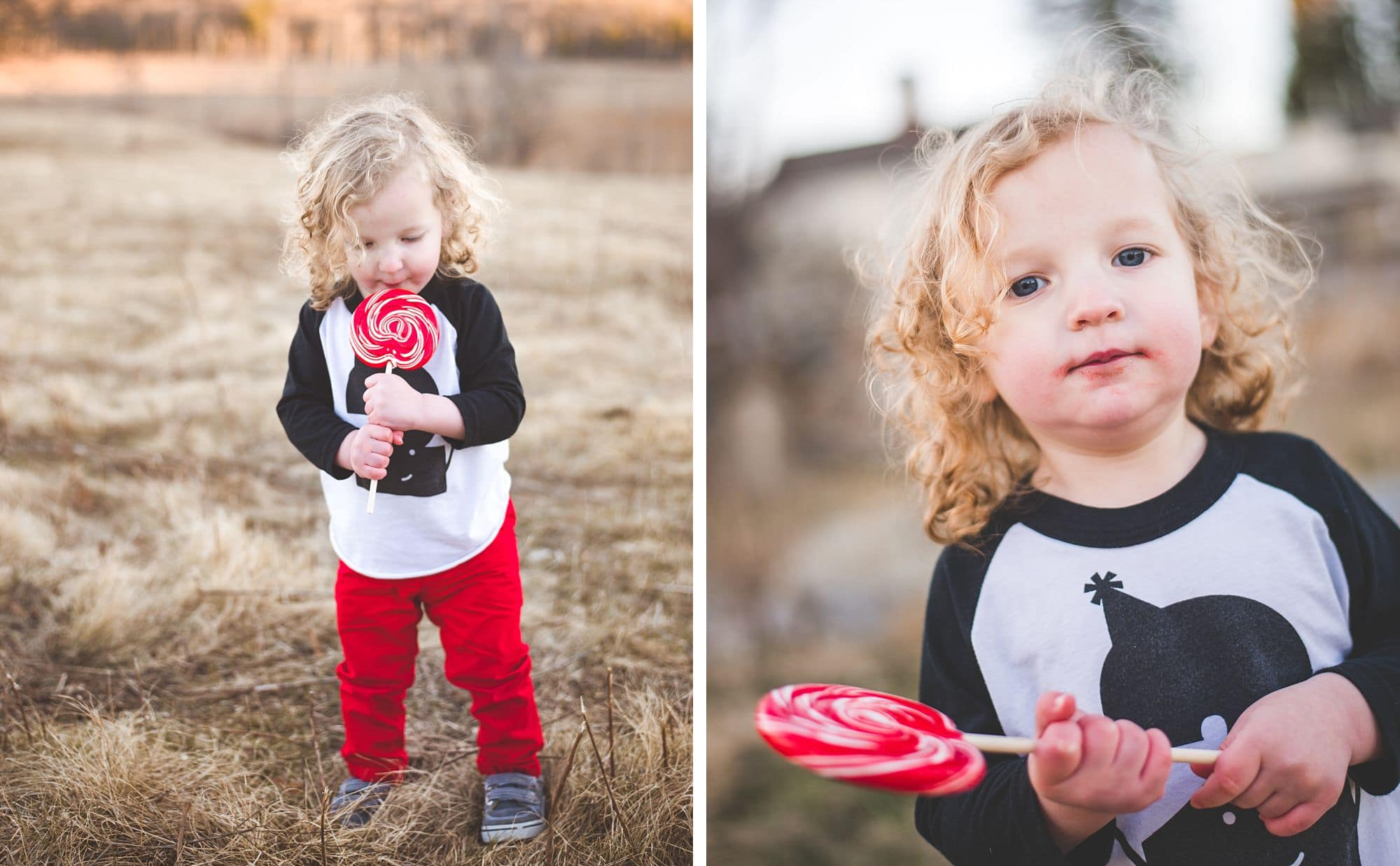 Young boy wearing red pants and a graphic tee enjoys a red lollipop