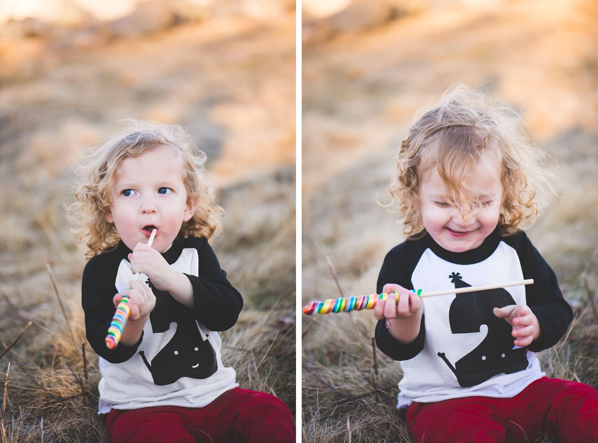 Silly toddler plays with a candy stick in a grassy field
