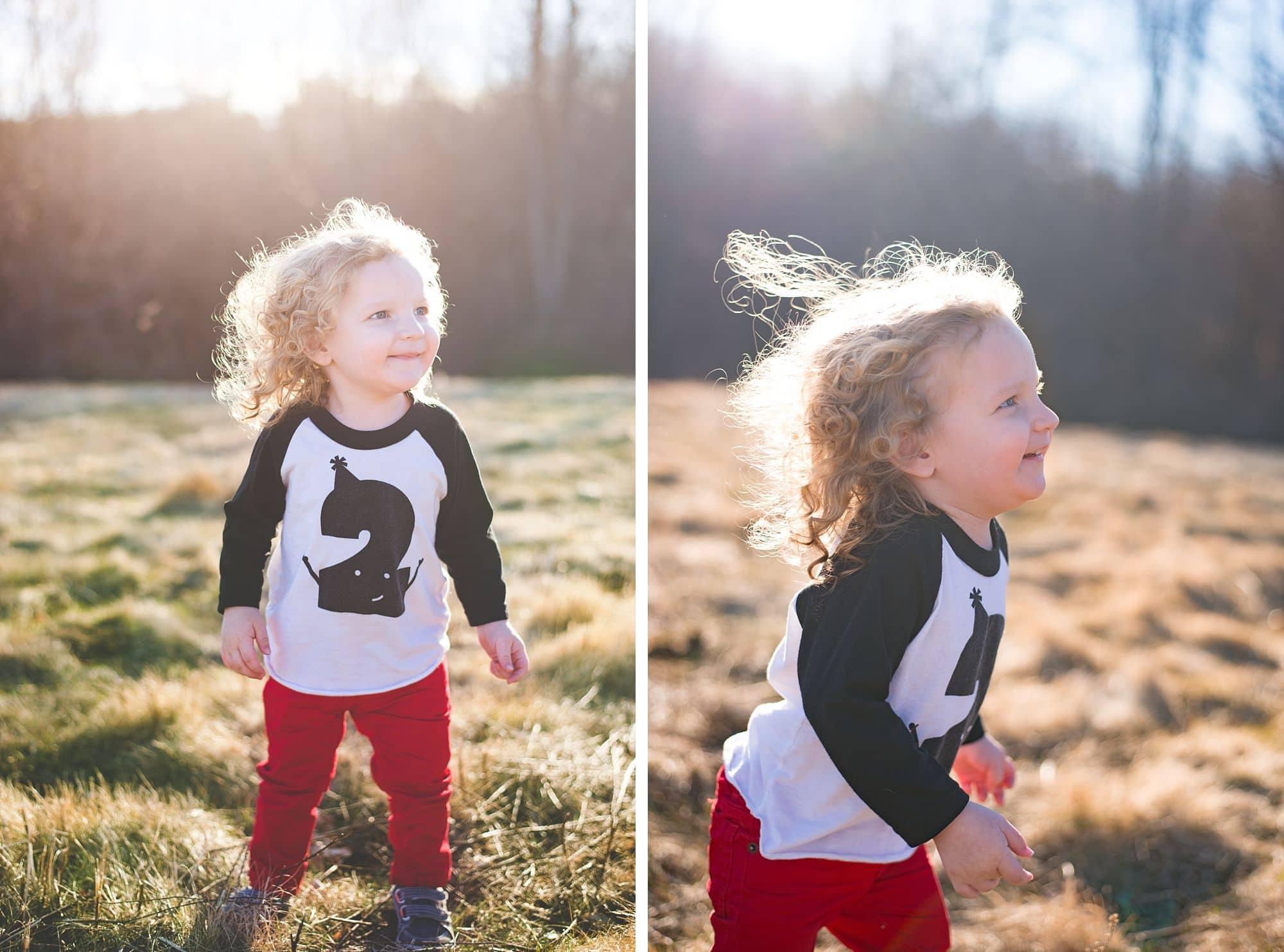 Joyful little boy dances in the sunlight
