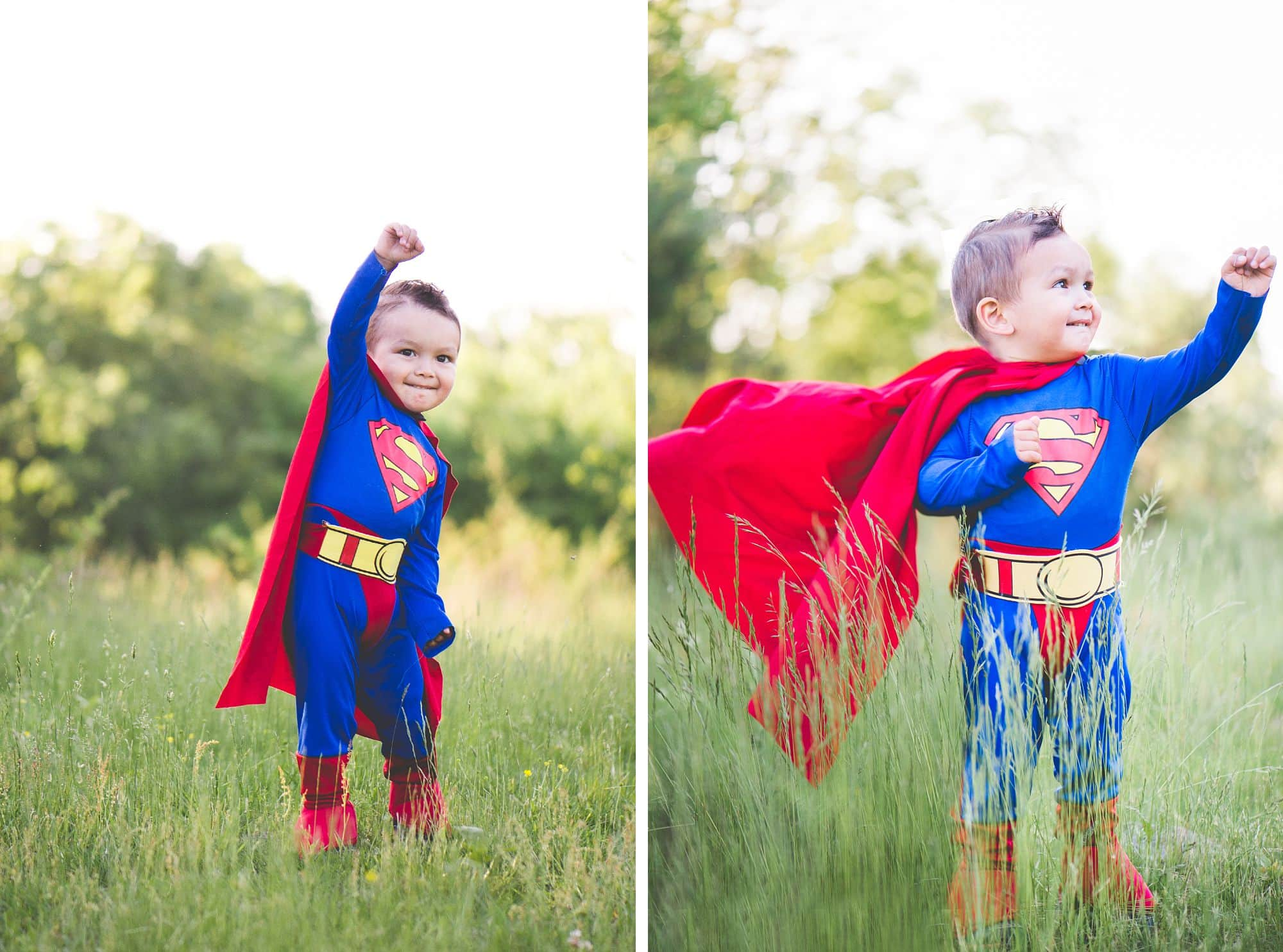 Toddler in superman costume looks ready to take off from grassy meadow