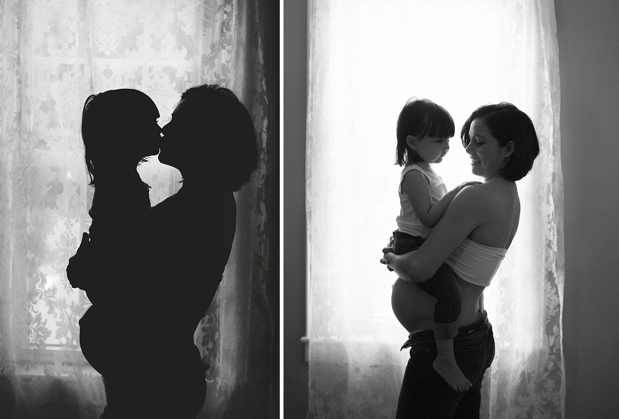 Pregnant mother and older child maternity picture in front of a window in black and white with a silhouette