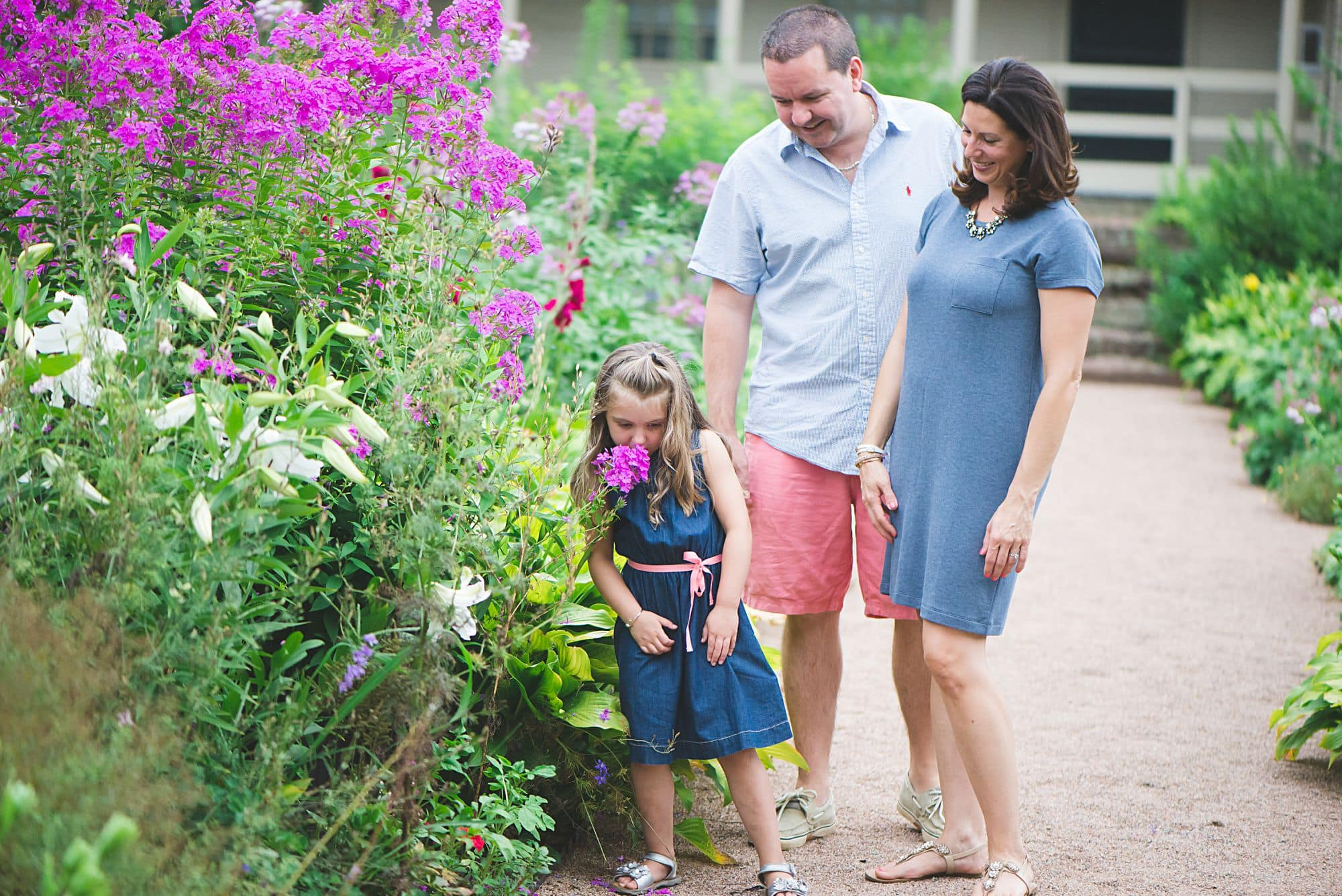 Casual family picture in a garden with pink flowers in Westherfield