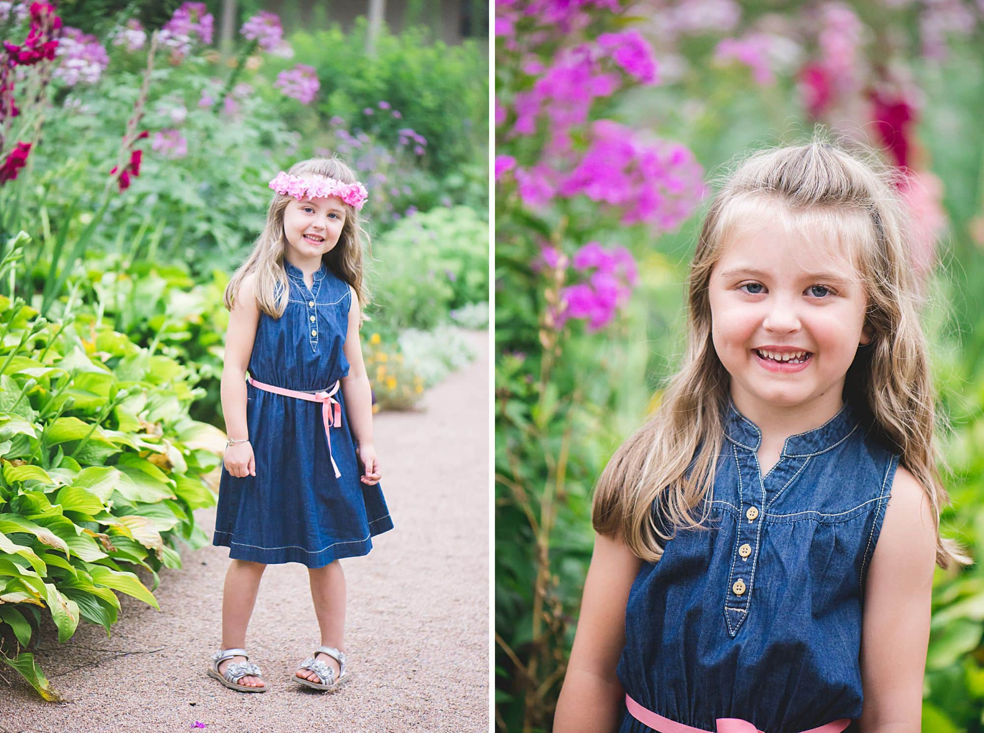 Young girl wearing a blue dress with pink belt outside in a garden in a natural fun pose