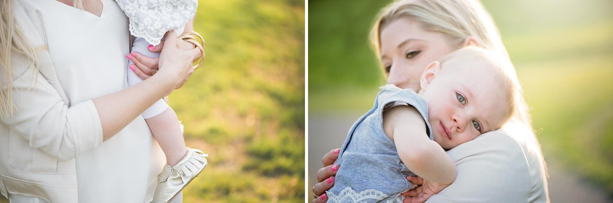 Mom hugging baby girl outside