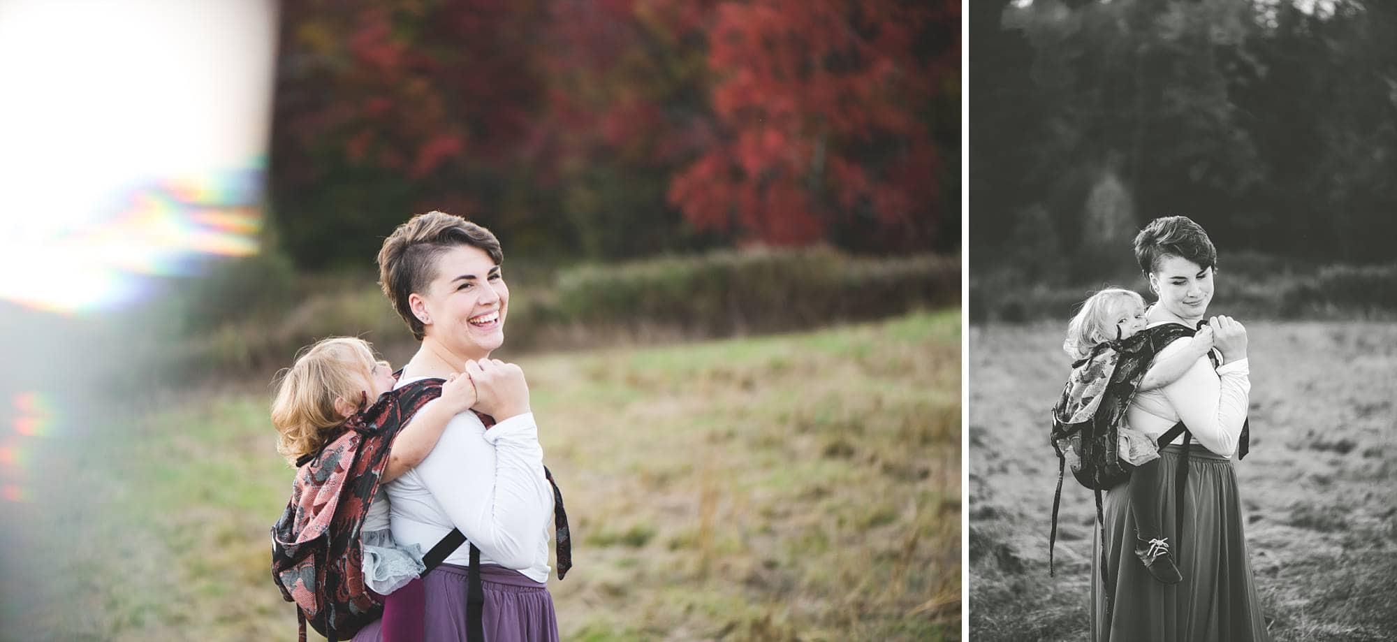 Mom wearing toddler girl in an onbu in a field