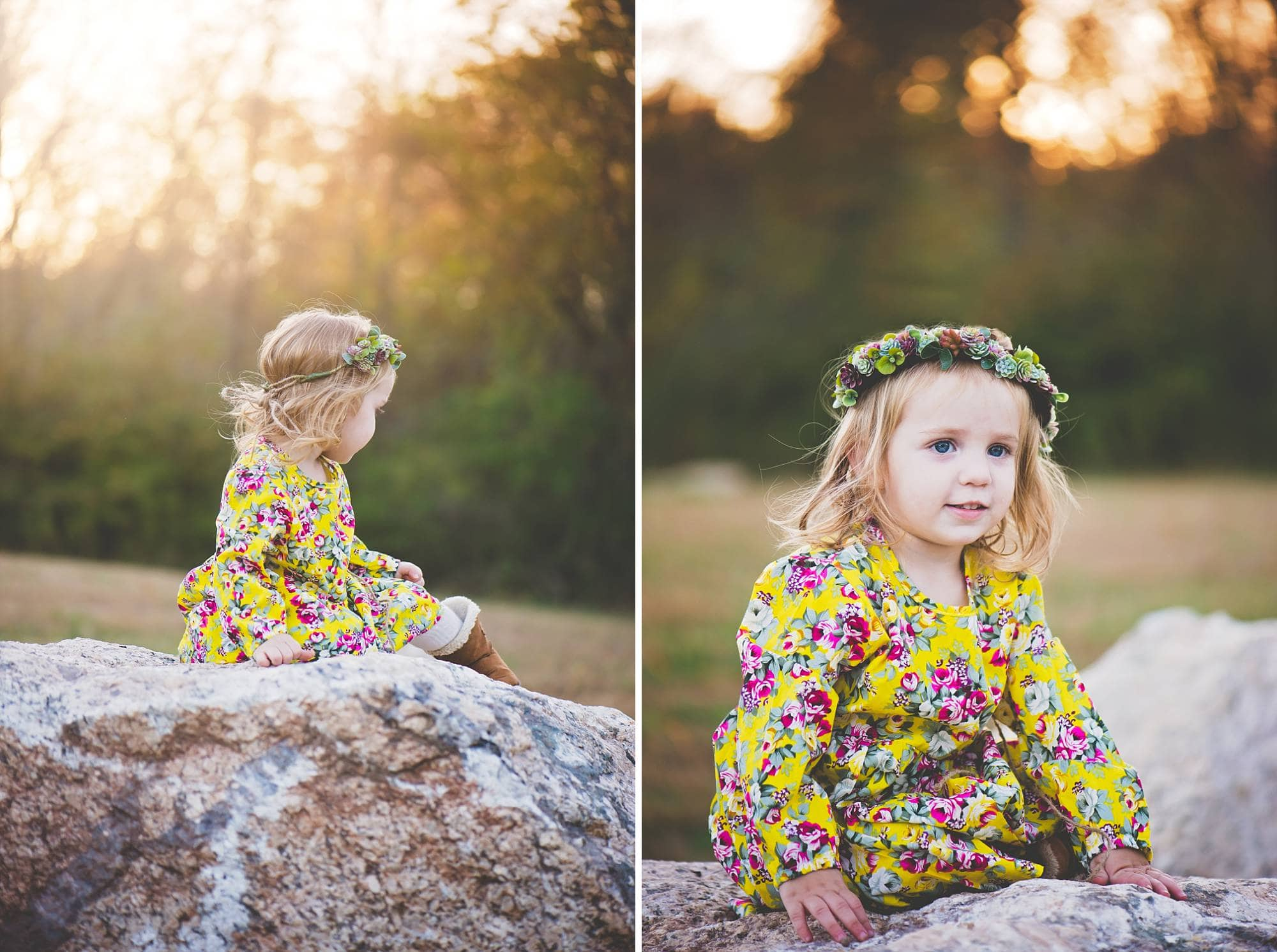 Toddler girl sitting on a rock in a field at sunset